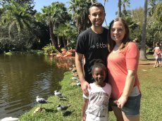 Adoptive Family Photo: Feeding Flamingos in Florida, click to view bigger version