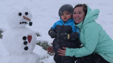 Adoptive Family Photo: Building a Snowman, click to view bigger version