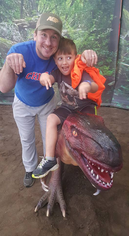 Adam & Our Nephew Having Fun at a Dinosaur Exhibit