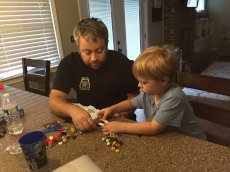 Adoptive Family Photo: They Love to Build Legos Together
