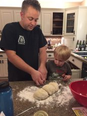 Adoptive Family Photo: Helping Daddy Cook