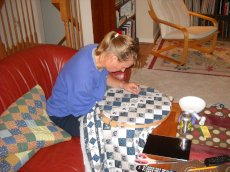 Adoptive Family Photo: Kathy Working a Quilt for a School Auction, click to view bigger version