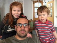 Adoptive Family Photo: Our Friend's Children in London Adore Levi! He Even Got His Hair Done., click to view bigger version