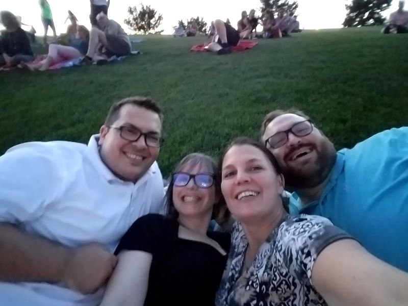 Watching an Outdoor Concert With Friends