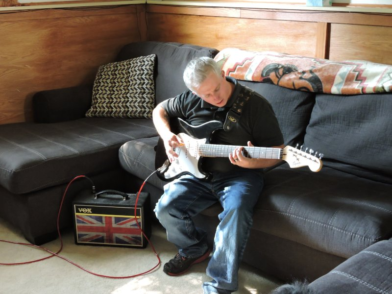 John Playing His Guitar