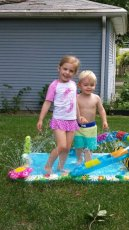 Adoptive Family Photo: Splash Pad With Rosie, click to view bigger version