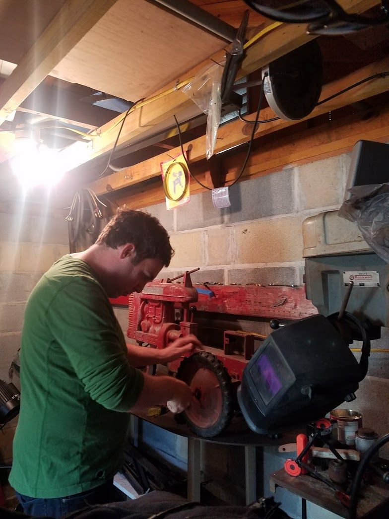 Ryan Restoring an Antique Toy Tractor