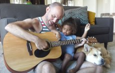 Adoptive Family Photo: Learning to Play Guitar Together, click to view bigger version