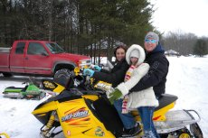 Adoptive Family Photo: Snowmobiling With Angel's Sister, click to view bigger version
