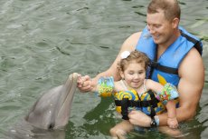 Adoptive Family Photo: Meeting a Dolphin in Mexico, click to view bigger version