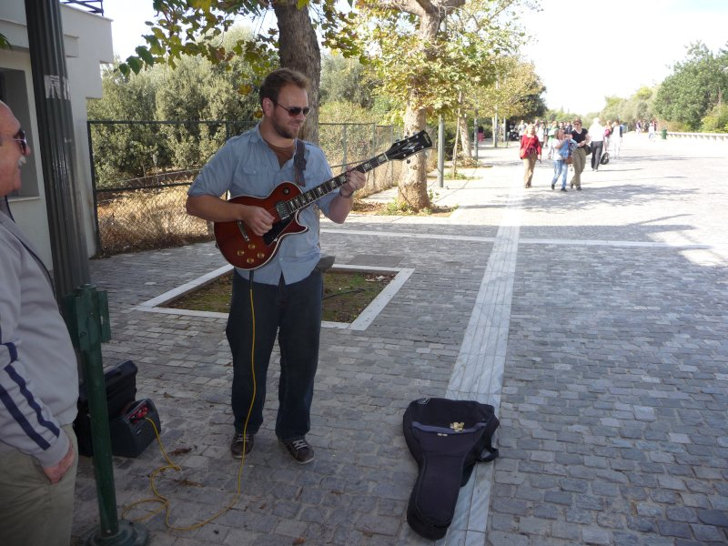 Playing Guitar on a Street in Greece