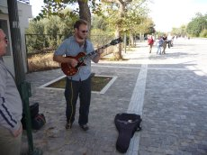 Adoptive Family Photo: Playing Guitar on a Street in Greece, click to view bigger version