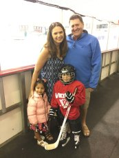 Adoptive Family Photo: Watching Anthony Play Ice Hockey, click to view bigger version