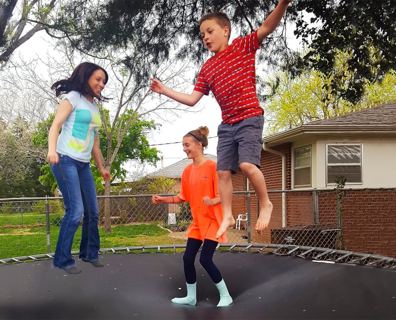 Lindsey Jumping on the Trampoline With Our Niece & Nephew