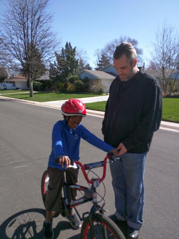 Teaching a Neighbor Kid How to Ride His Bike