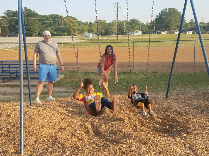 Pushing Our Niece & Nephew on the Swings