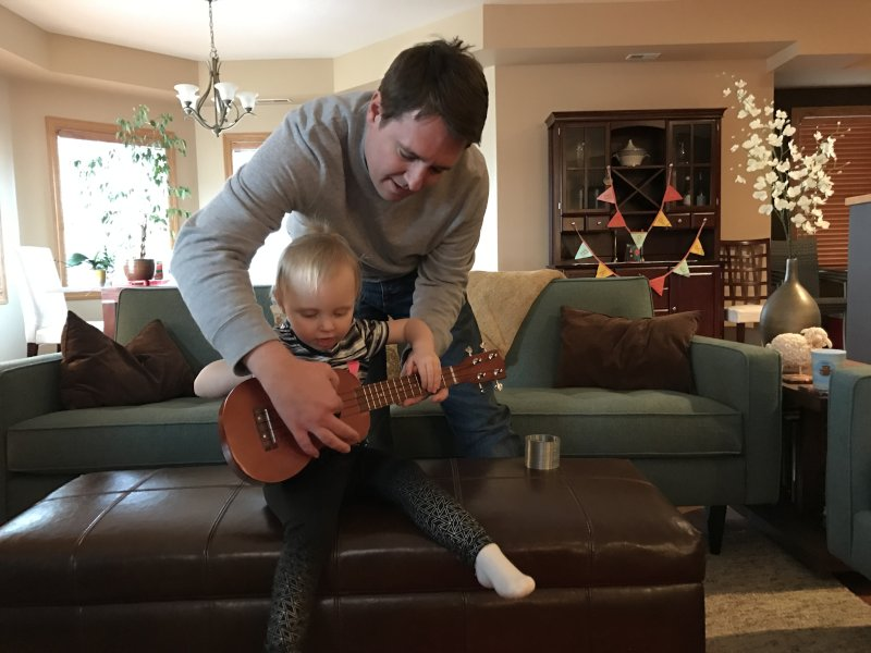 Scott Teaching Our Niece the Ukelele