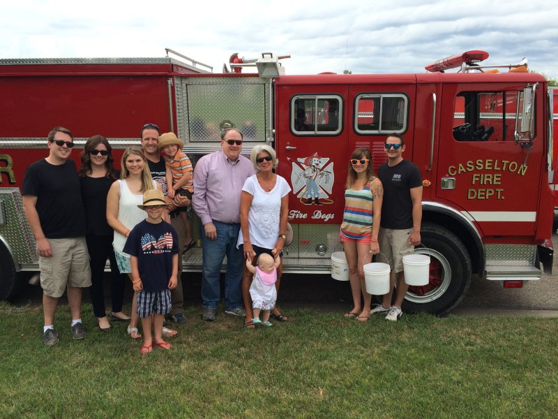 Getting Ready to Toss Candy From the Fire Truck During Community Days with Laura's Family