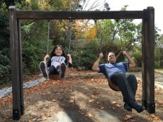 Adoptive Family Photo: Swinging with Dad, click to view bigger version