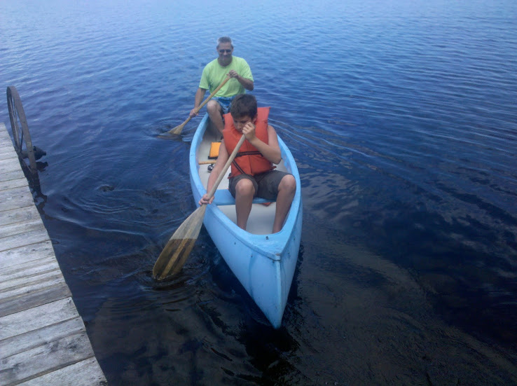 Chuck Teaching Step Son to Canoe