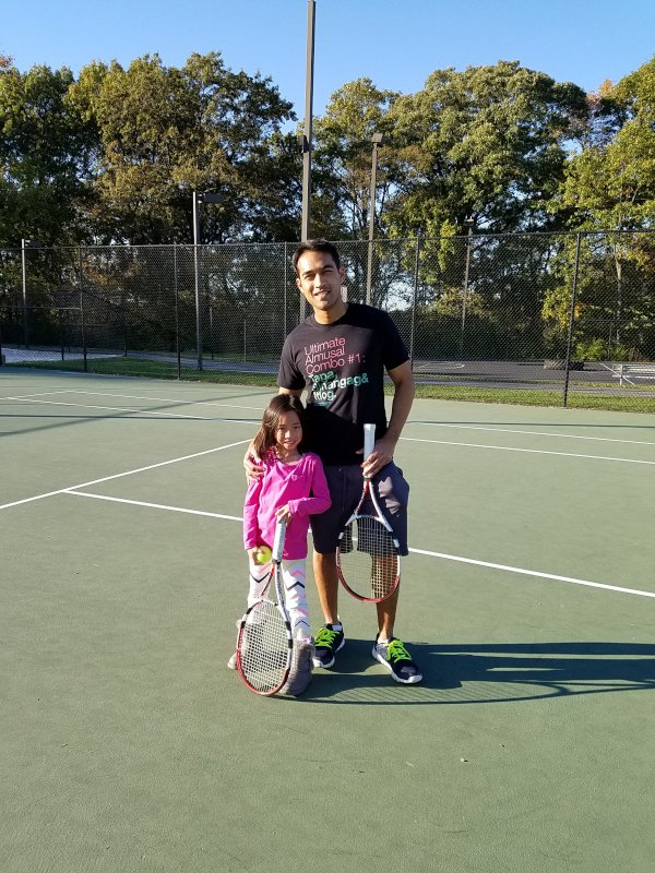 Playing Tennis with Our Niece