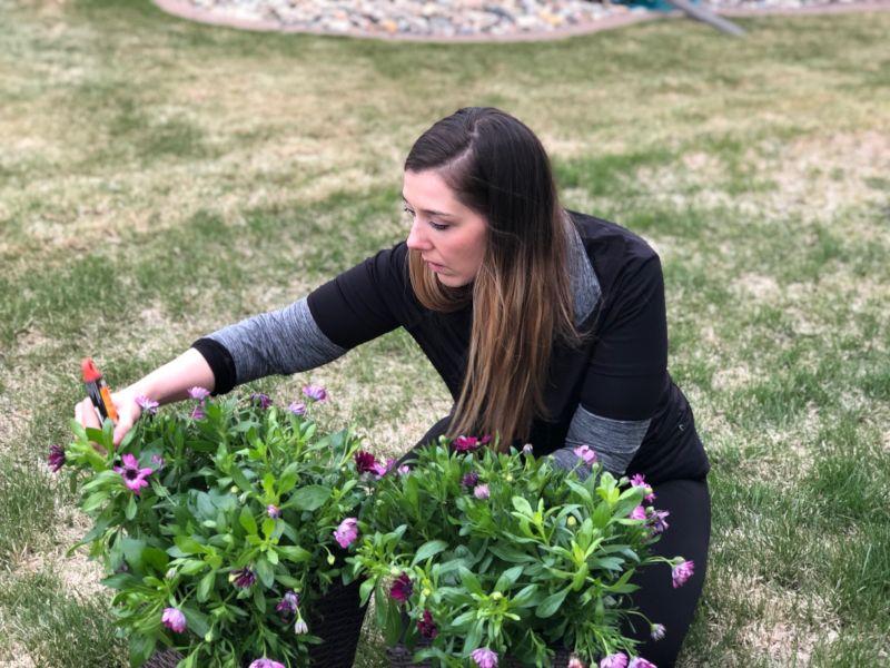 Vanessa Planting Her Flowers
