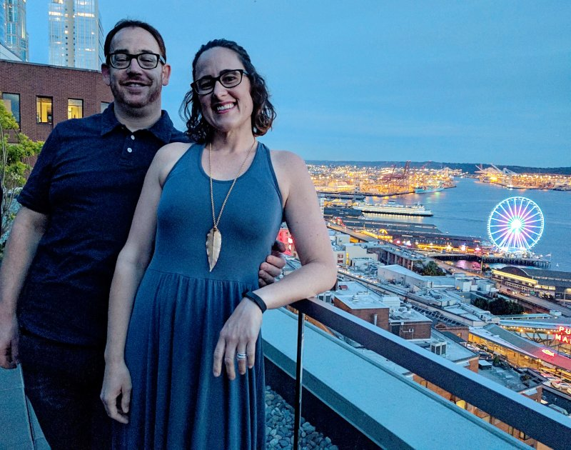 Enjoying Each Other's Company While Overlooking the Seattle Waterfront