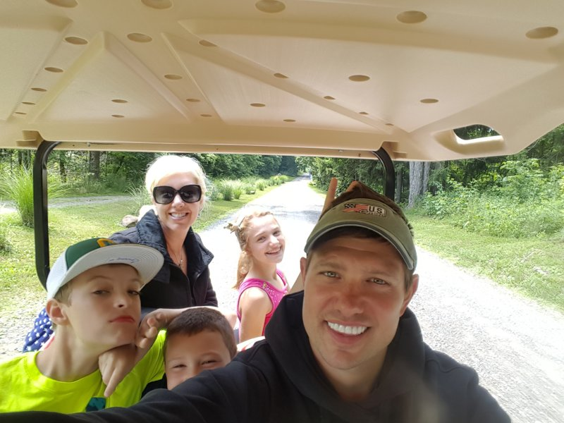 Driving Our Niece and Nephews in the Golf Cart