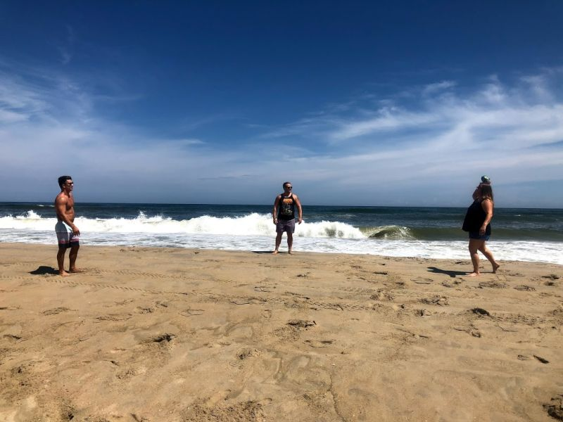 Playing Football at the Beach With Friends