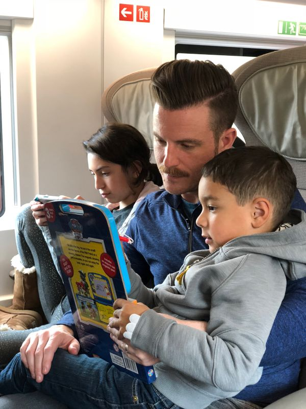 Michael R. With Our Niece & Nephew on the Train to Paris