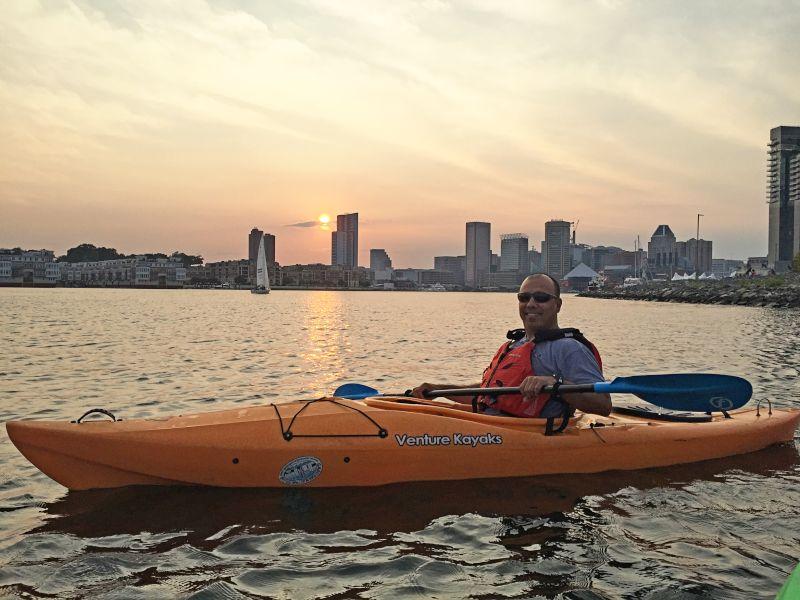 Kayaking Along the City Skyline