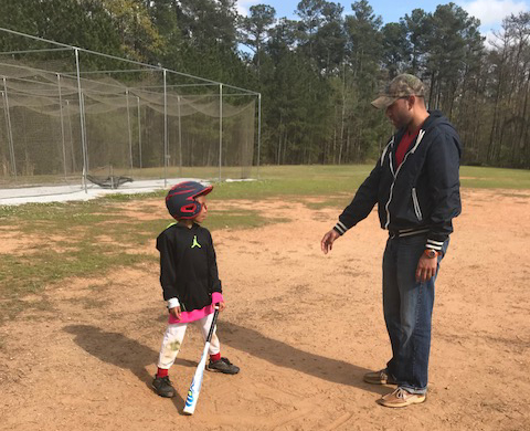Teaching Our Goddaughter to Play Baseball