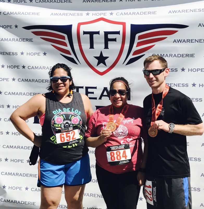 Andrea With Her Sister & Brother-in-Law After a 5K Run