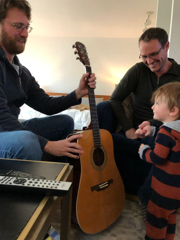 Teaching His Godson How to Play