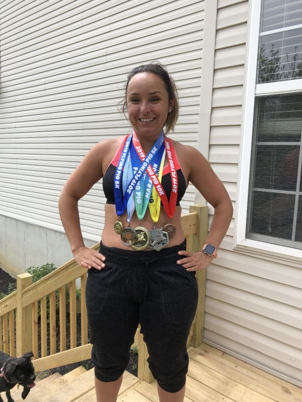 Lillia Showing Off Her Marathon Medals