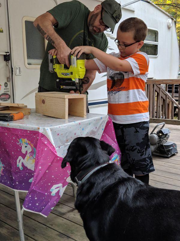 Pete Teaching a Friend's Son Woodworking