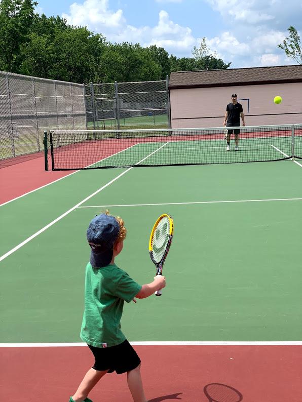 Patrick Teaching Austen Tennis