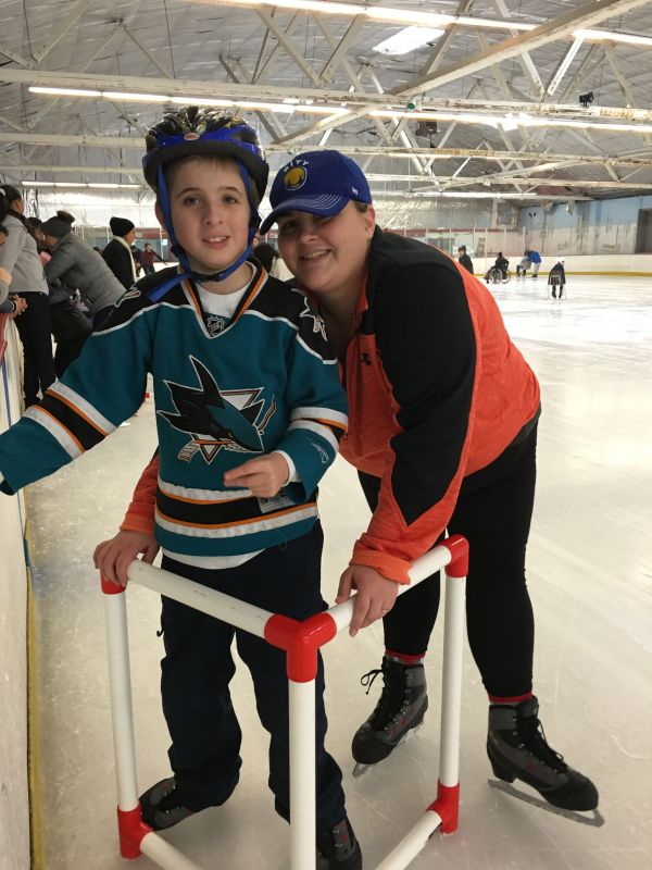 Allie Skating With a Student