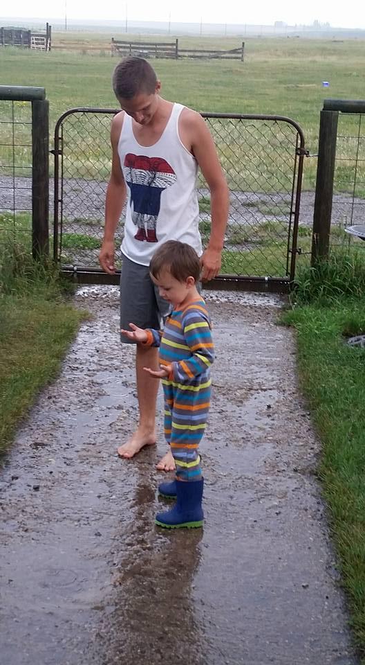 Dylan & Our Nephew Splashing in the Rain