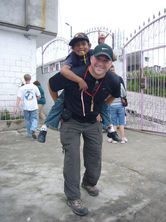 Kevin Playing With the Kids in Ecuador
