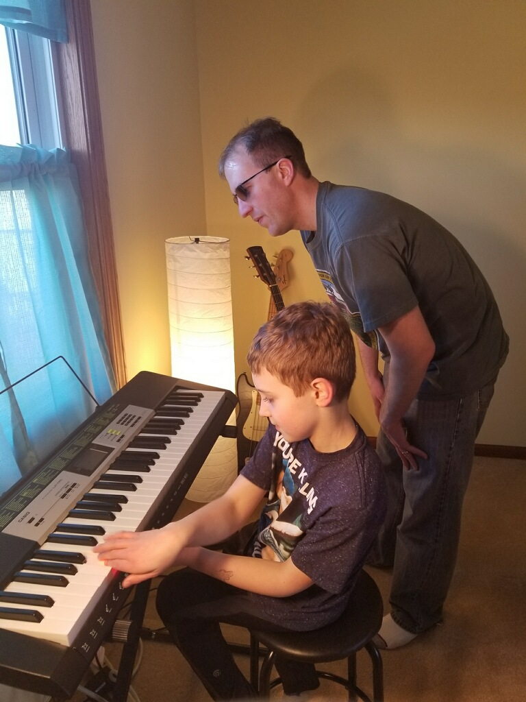 Mike Teaching His Cousin Piano