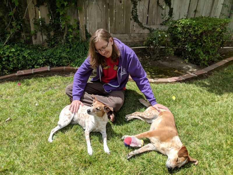 Nic With the Dogs in the Backyard