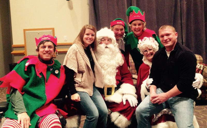 Visiting with Santa, Mrs. Claus, and the Elves