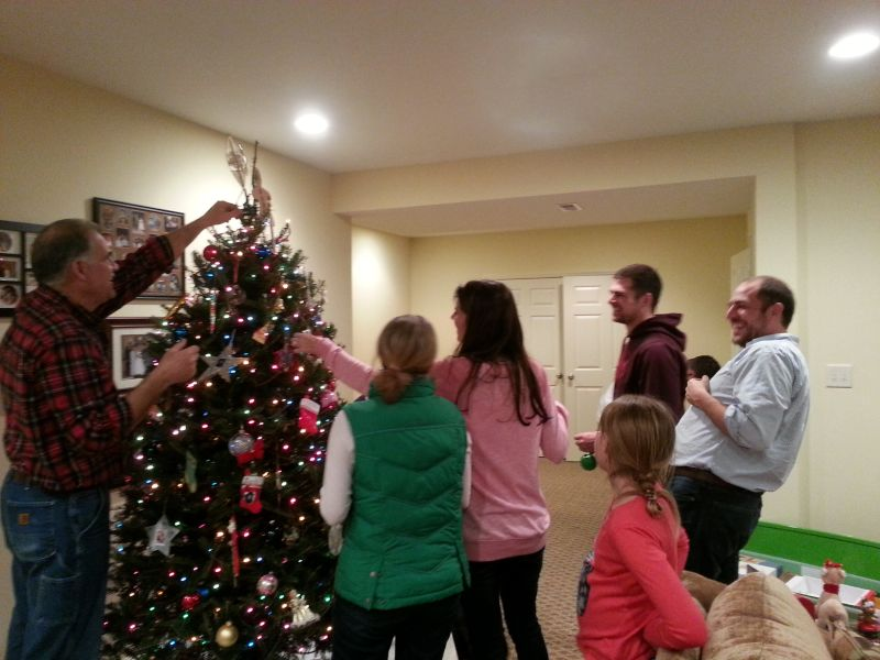Decorating the Christmas Tree With Family