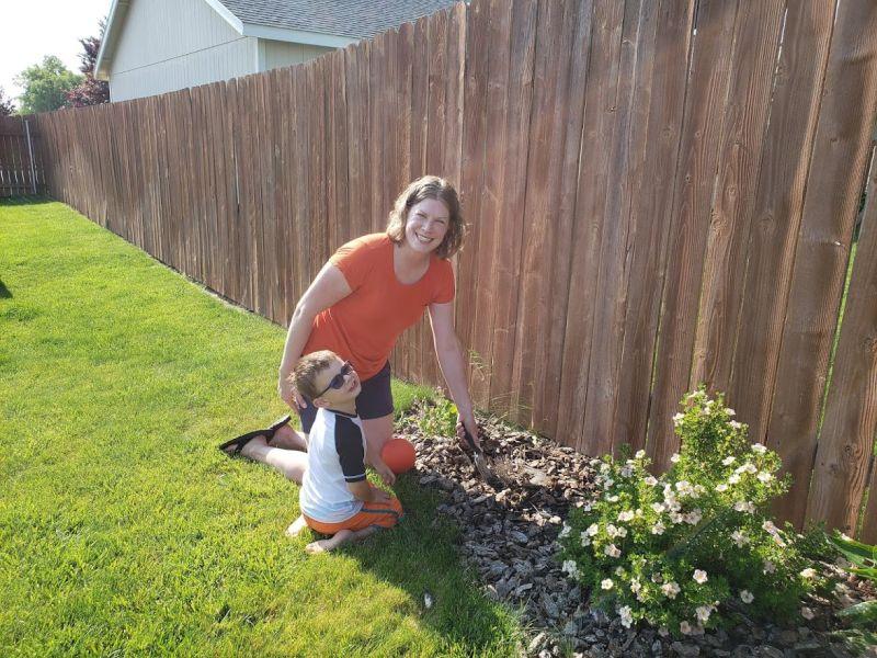 Helping Mom Plant Flowers
