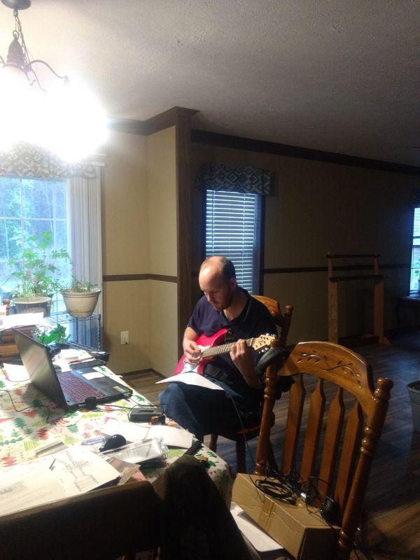 Jonas Practicing His Guitar