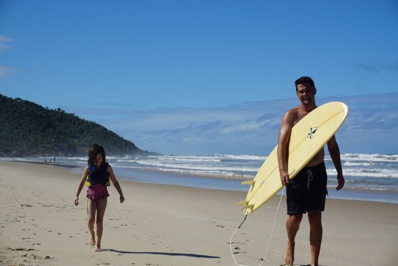 Peter & Grace Heading Out to Surf in Brazil