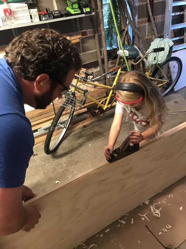 Greg Teaching Our Niece Woodworking