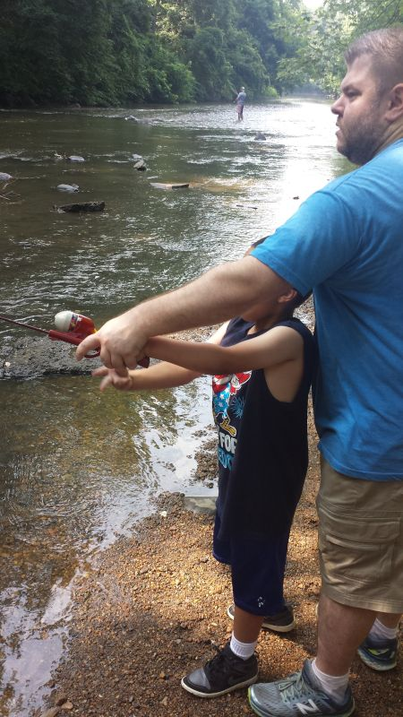 John Teaching Our Nephew How to Fish
