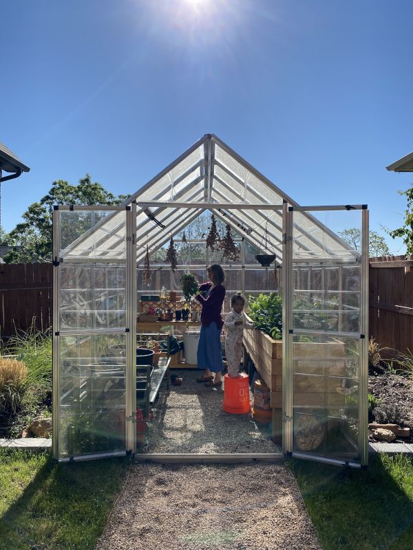 Hillary in Her Greenhouse